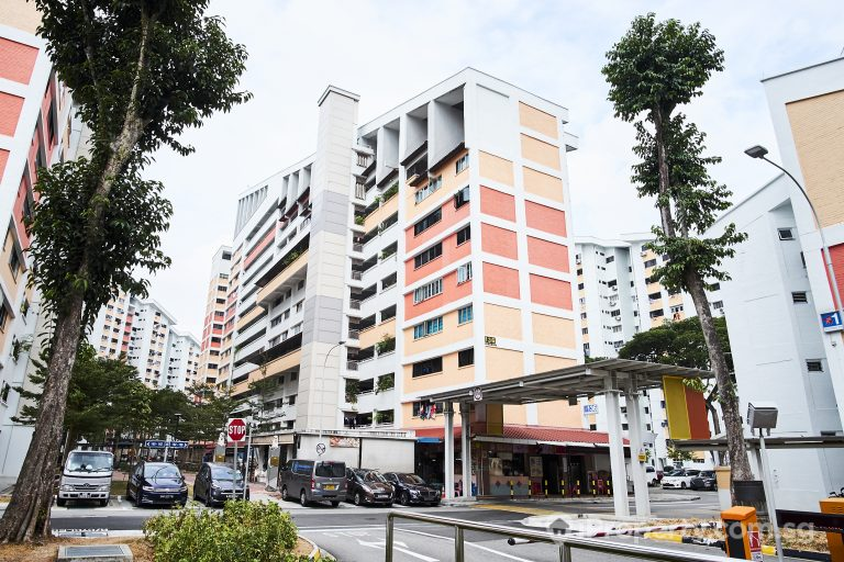 Orange white HDB building in block 136 potong pasir avenue 3 in singapore