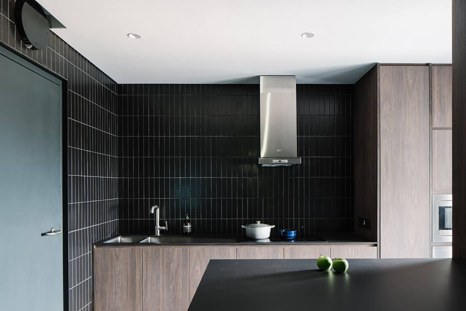Vertical aspects will naturally make your space look like it has a taller ceiling