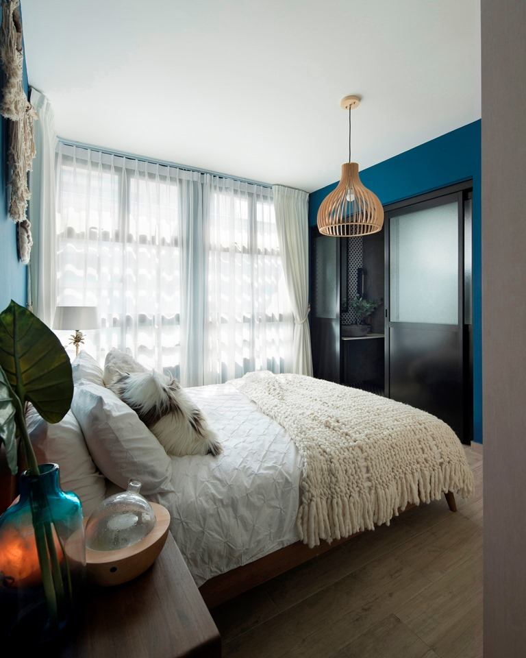 Hang your curtains as close to the ceiling as you can to create the illusion of a taller ceiling